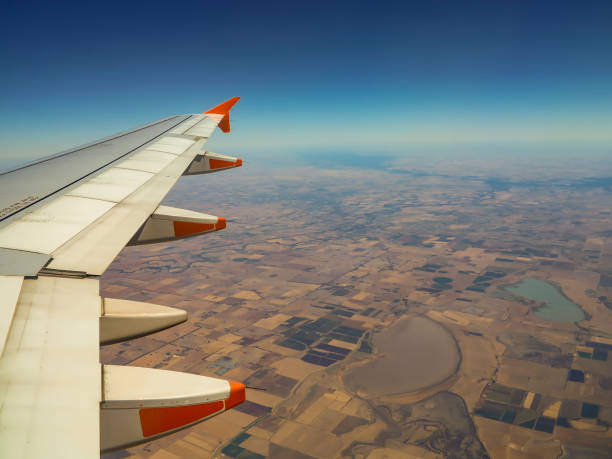 Looking through window in airplane above drought view of Victoria Australia stock photo