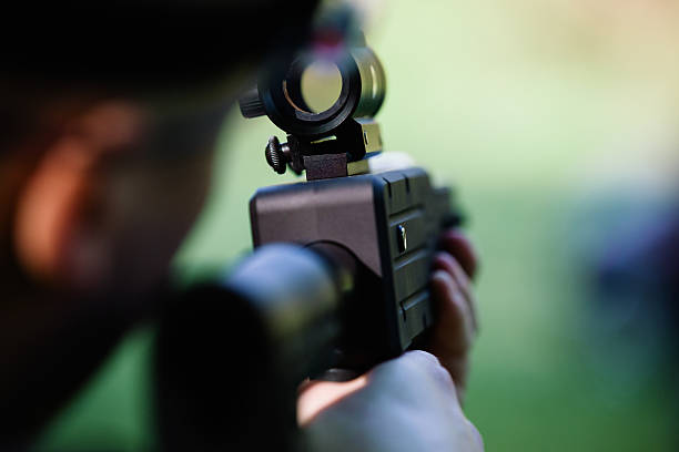 Looking throught the rifle scope Unrecognizable person is looking throught the rifle scope ambush stock pictures, royalty-free photos & images