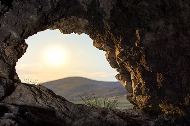 looking thru a cave opening stock photo