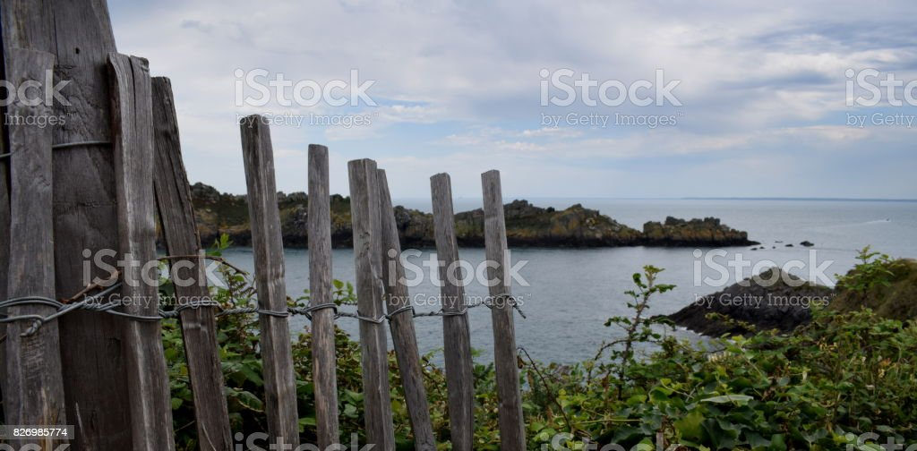 Looking to an island off the coast in Brittany, France. stock photo