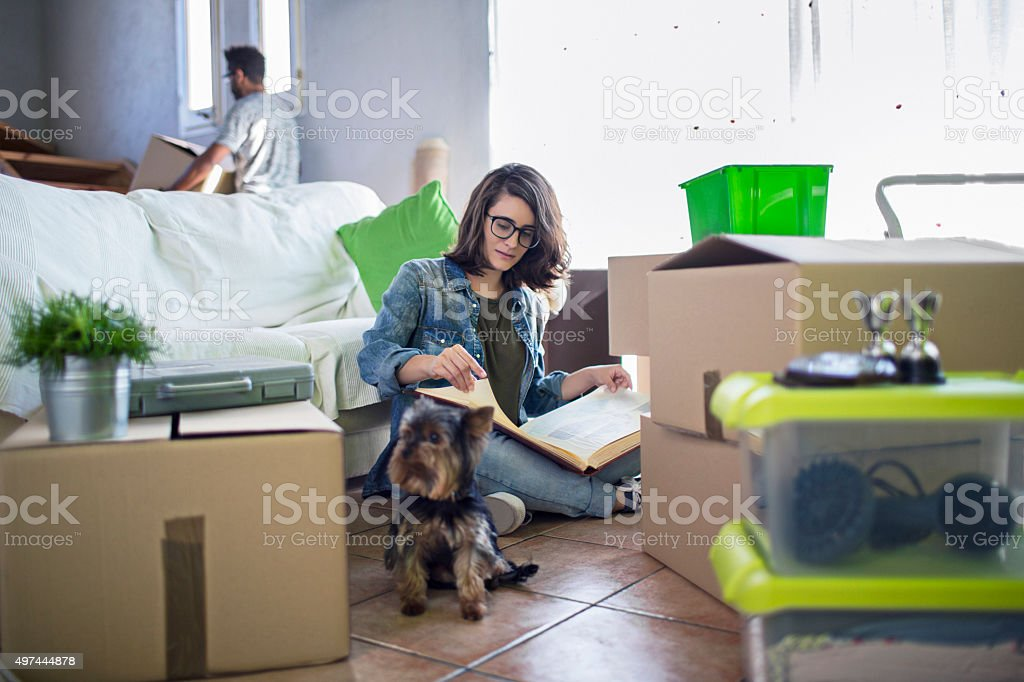 Looking to an old album at the new home stock photo