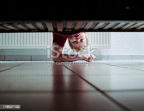 Young boy looking under his bed for a missing item. http://img75.imageshack.us/img75/3808/people200801auv1.jpg