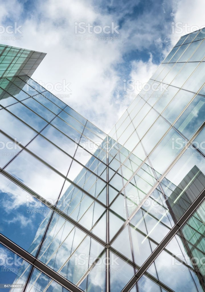Looking up a reflections on glass covered corporate building stock photo