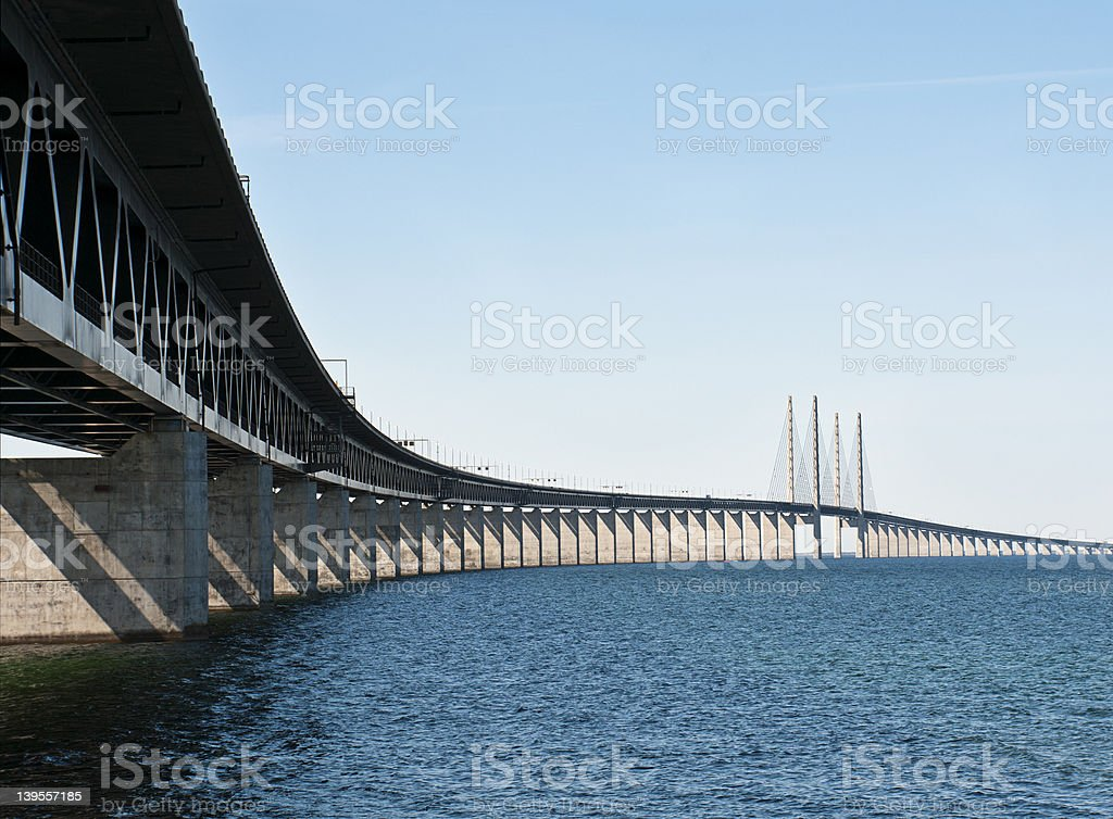 Looking Up and Across a Long Bridge Over Water stock photo