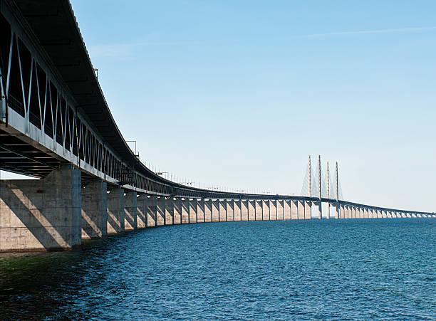 looking up and across a long bridge over water - öresund bildbanksfoton och bilder