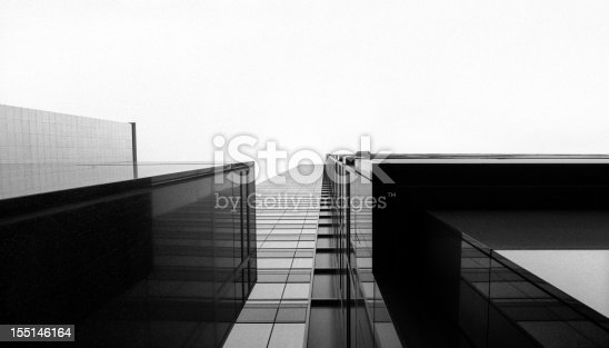 istock Looking up at a glass skyscraper 155146164