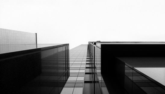 Looking up at a glass skyscraper