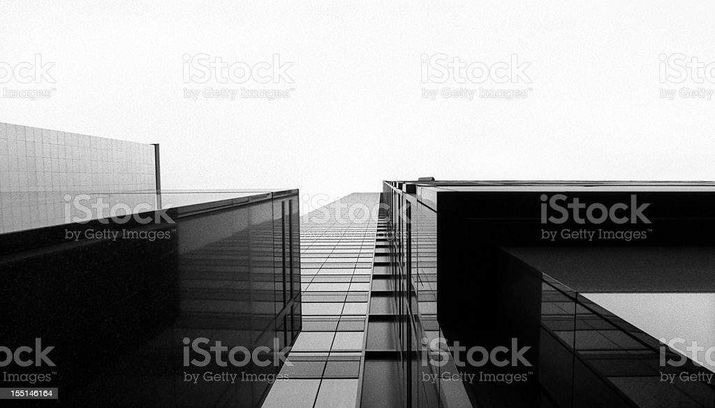 Looking up at a glass skyscraper stock photo