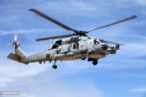 istock Looking up at a Seahawk helicopter flying in blue sky 184324252