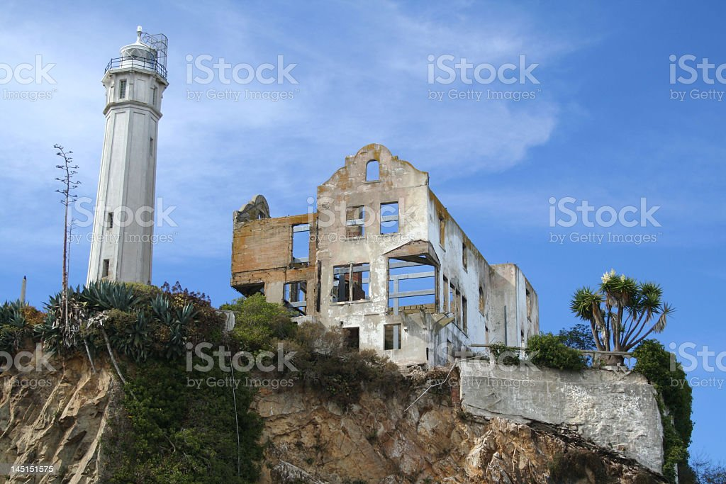 Looking up at Alcatraz prison and lighthouse on a sunny day stock photo
