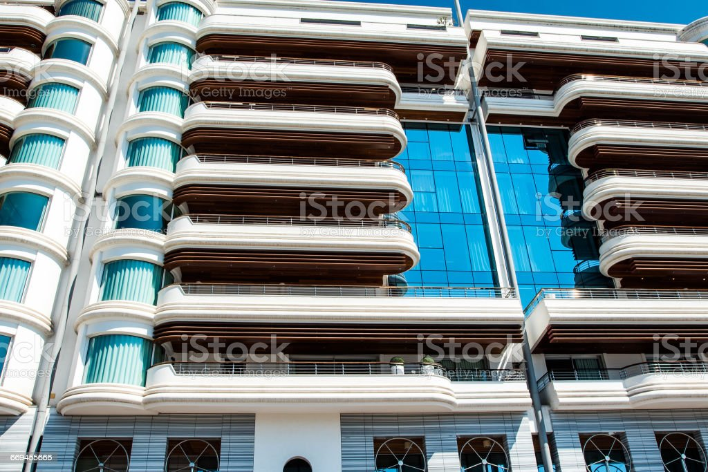 looking up at  apartment building stock photo