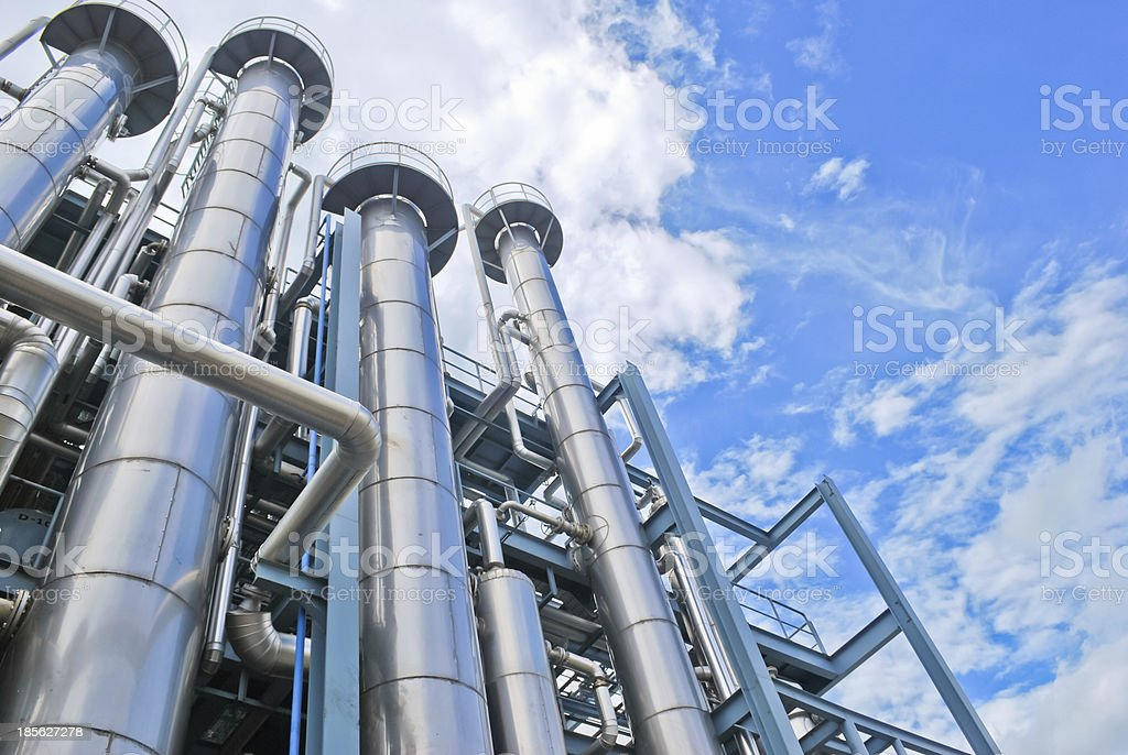 Looking up at chemical plant stacks stock photo
