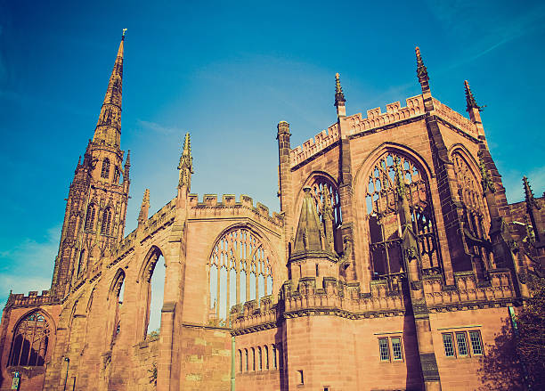Looking up at Coventry Cathedral and the blue sky