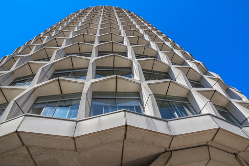 Looking up at cylindrical building One Kemble Street, aka Space House, in London