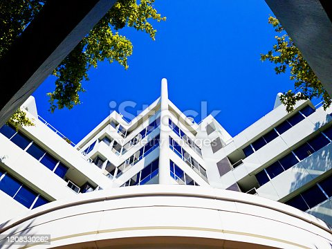 A low-angle look up at a dramatically shaped building, a mix of angles and curves.