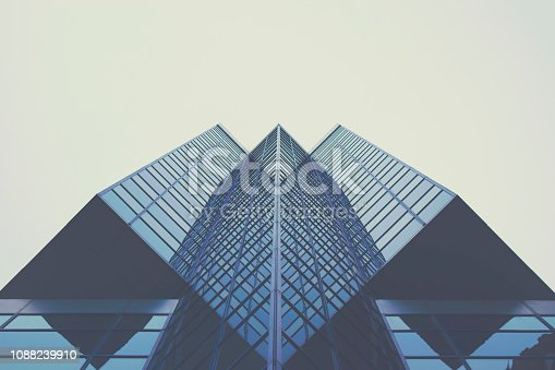 Picture of a modern glass building from a very unique angle.