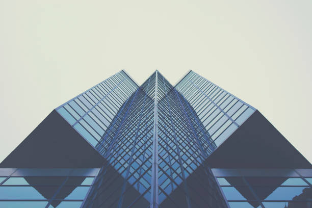 Looking up at Modern Building Picture of a modern glass building from a very unique angle. directly below stock pictures, royalty-free photos & images