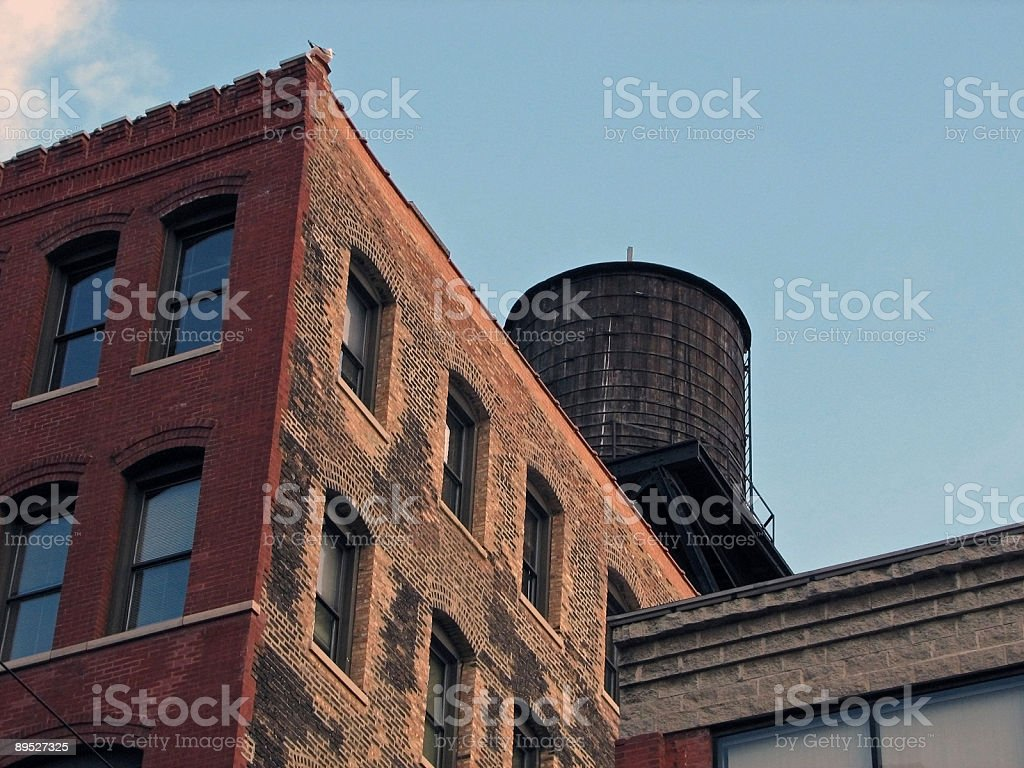Looking Up at Multistory Warehouse and Water Tank royalty-free stock photo