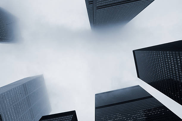 Looking Up at Skyscraper Office Buildings with Fog stock photo