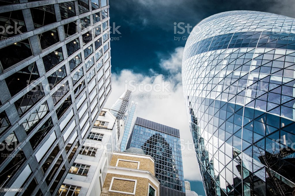 Looking up at skyscrapers in City of London stock photo