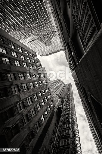 Looking at the sky between skyscrapers in New York City