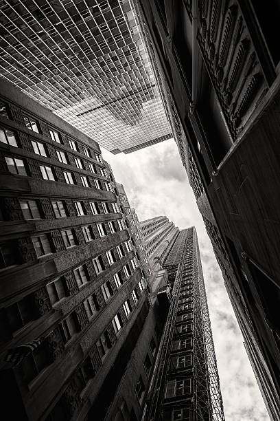 looking up at skyscrapers in new york - urban sprawl stock photos and pictures