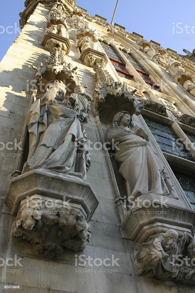 looking up at statues, Bruges, Belgium royalty-free stock photo