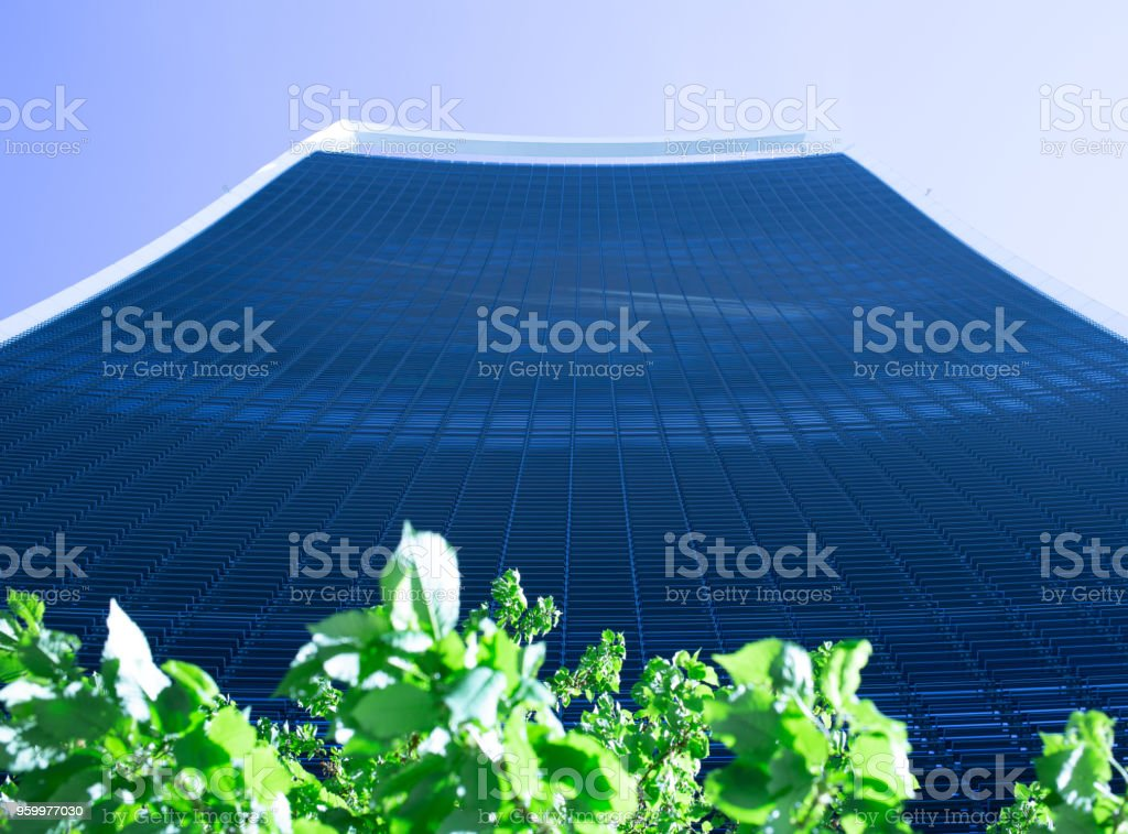 Looking up at the amazing design and architecture of the Walkie-Talkie Building on a stunning clear blue sky morning stock photo