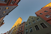 Looking up at the beautiful old houses in the Wahlenstraße of Regensburg, Germany in first light of day
