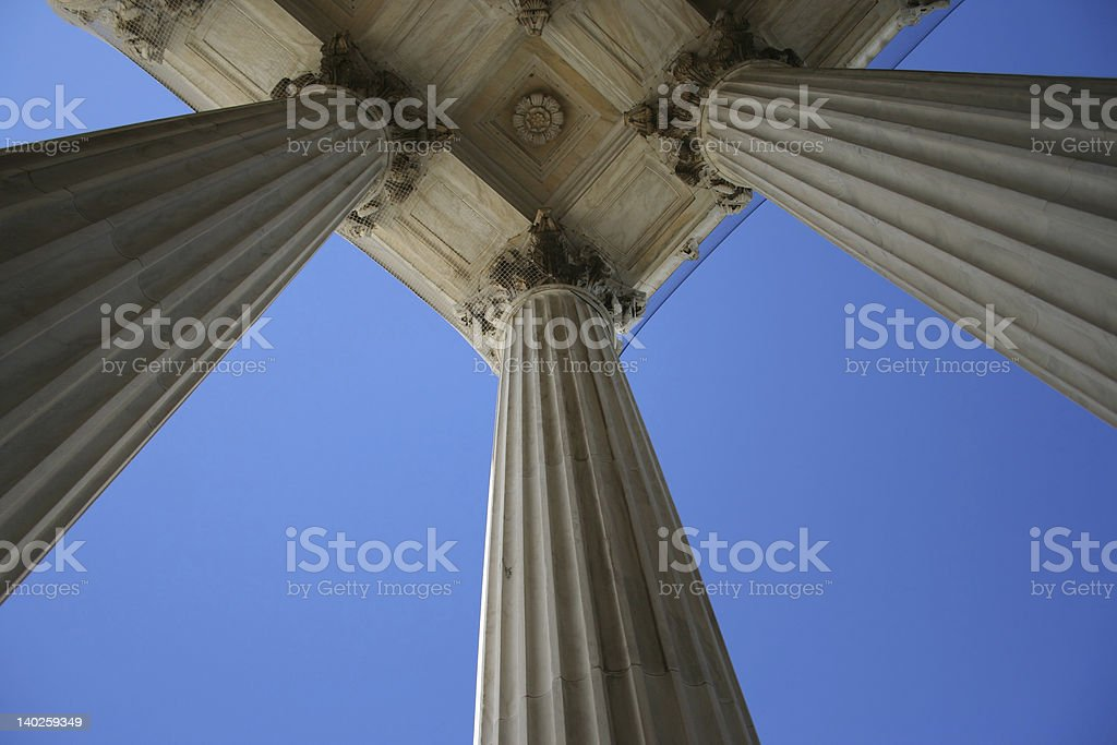 Looking up at the marble columns of the Supreme Court  stock photo