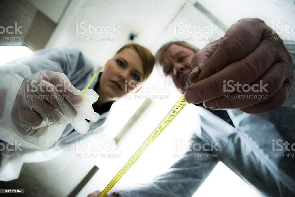Looking up at Two Crime Scene Investigators royalty-free stock photo