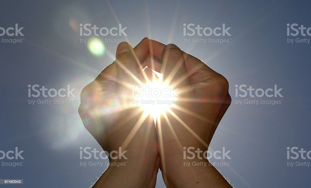Looking up at two hands cupping the sun royalty-free stock photo