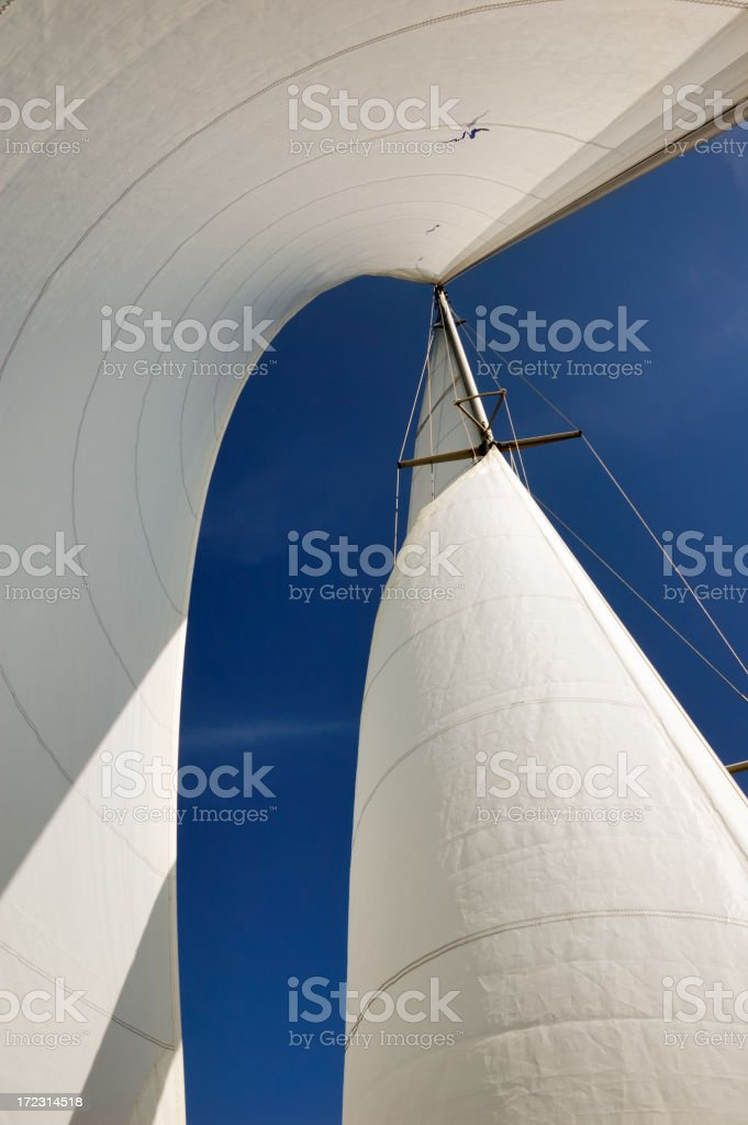Looking up from a vessel at the fully open sails stock photo