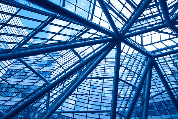 looking up into modern glass and steel business facade stock photo
