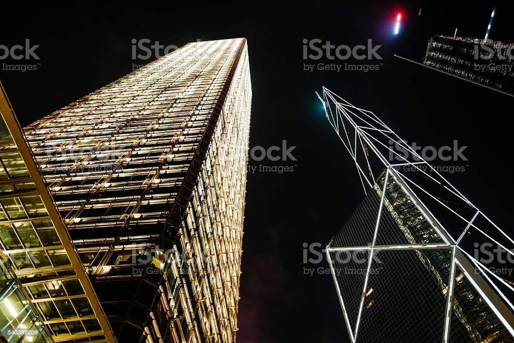 Looking up night view of skyscrapers in Hong Kong stock photo