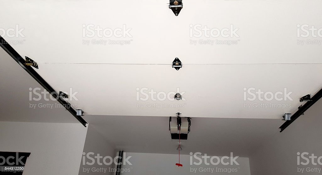 Looking Up To Mechanics Of An Automatic Garage Door stock photo