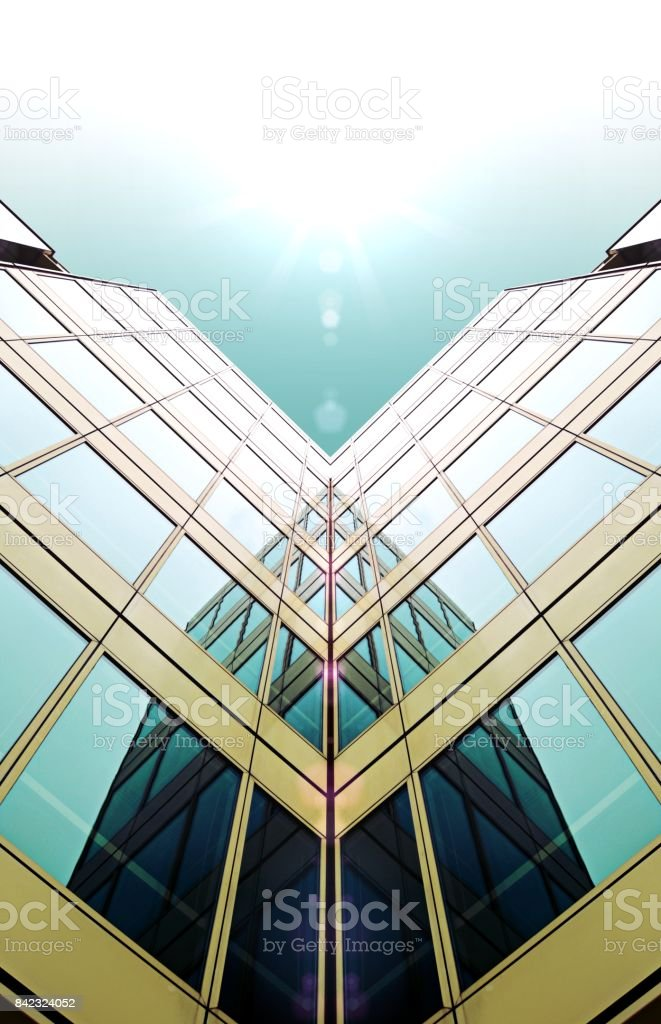 Looking up view of a modern High Rise Glass Office Building in England under blue sky stock photo