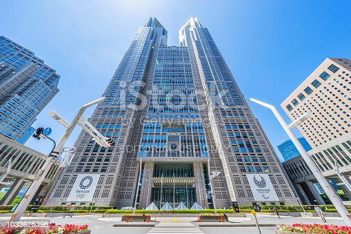 1188904934 istock photo looking up view of Tokyo Metropolitan Government Building with Tokyo 2020 Olympic Games logo 1033625398