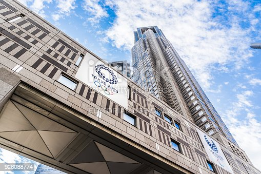 1188904934 istock photo looking up view of Tokyo Metropolitan Government Building with Tokyo 2020 Olympic Games logo 926088774