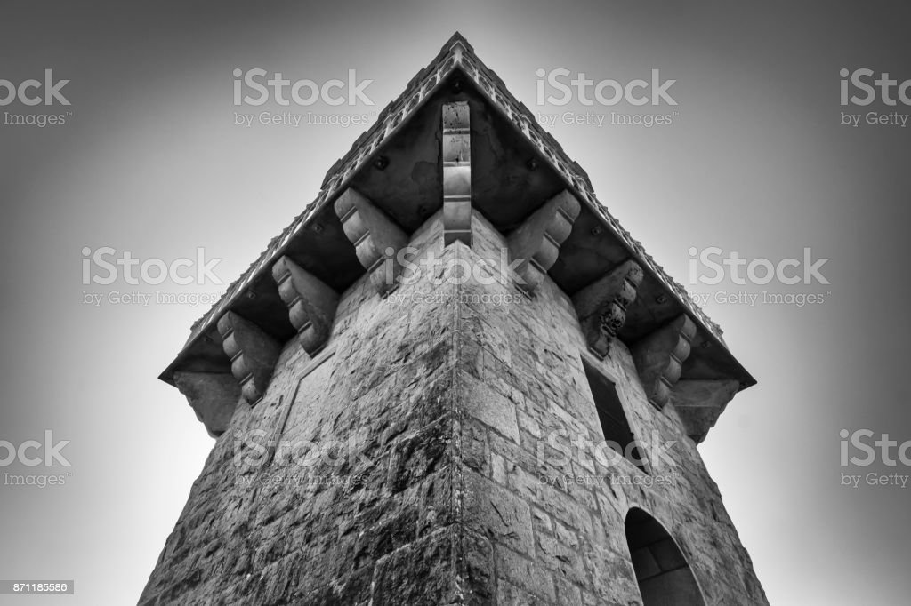Looking upward at an old brick tower against the sky. Centenary Tower, Mount Gambier, South Australia from below. stock photo