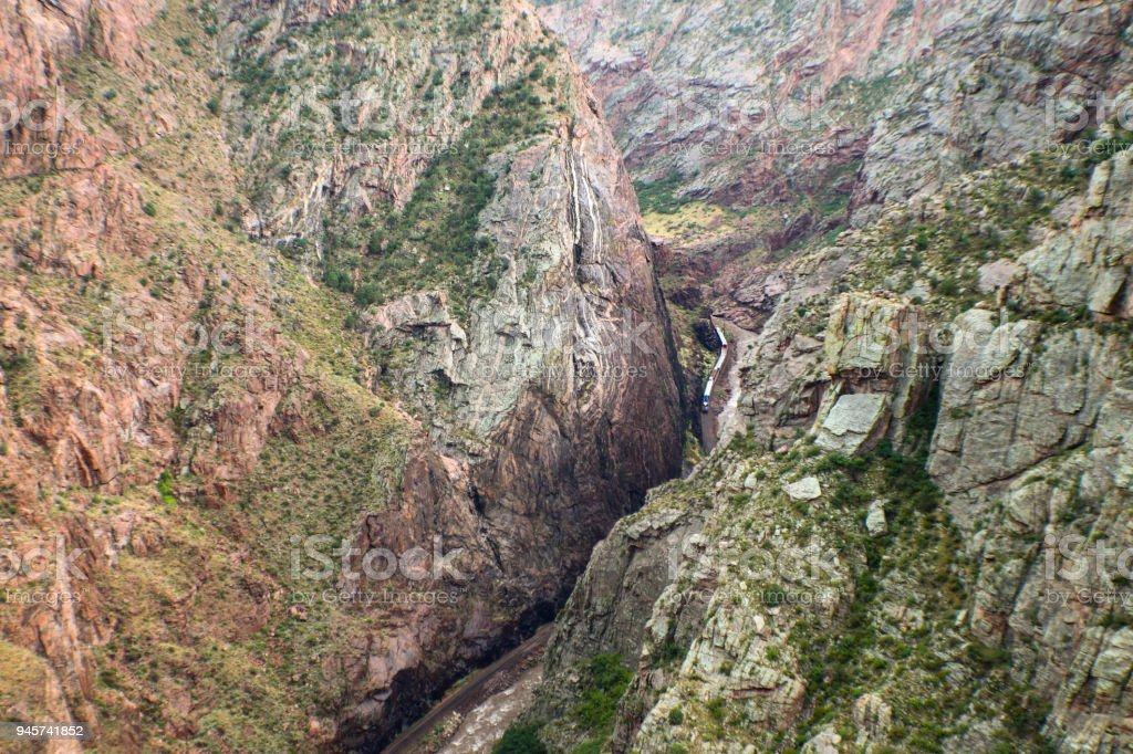 Looking way down at the Arkansas River and train running beside it in the  Royal Gorge in Colorado stock photo