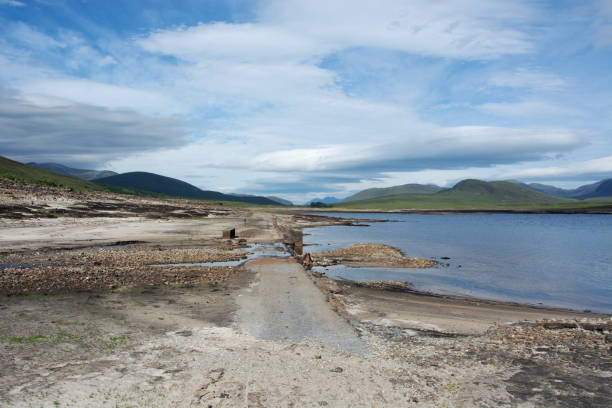 Looking westwards towards the second bridge and road which are both normally submerged under Loch Glascarnoch stock photo