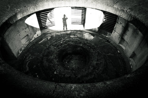 Looking_down_into_abandoned_military_fotification_shadow stock photo