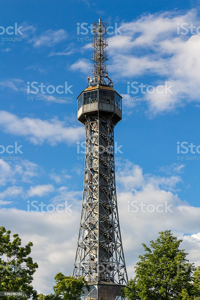Lookout tower on the Petrin Hill in flowering spring park royalty-free stock photo