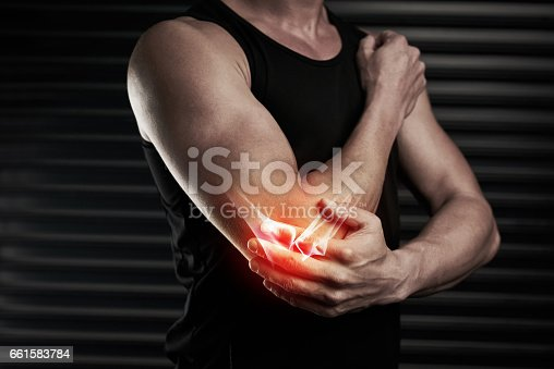 Shot of an unrecognizable young man with an elbow injury in the studio