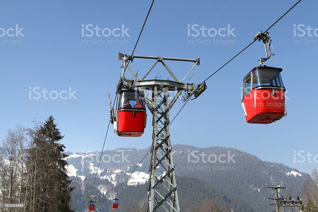Look-up of red cable cars in Berne Canton of Switzerland royalty-free stock photo