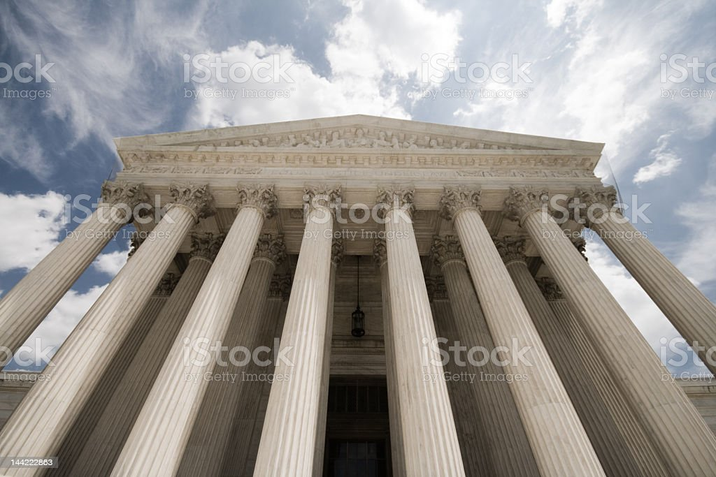 Looming Justice Facade of United States Supreme Court Building royalty-free stock photo