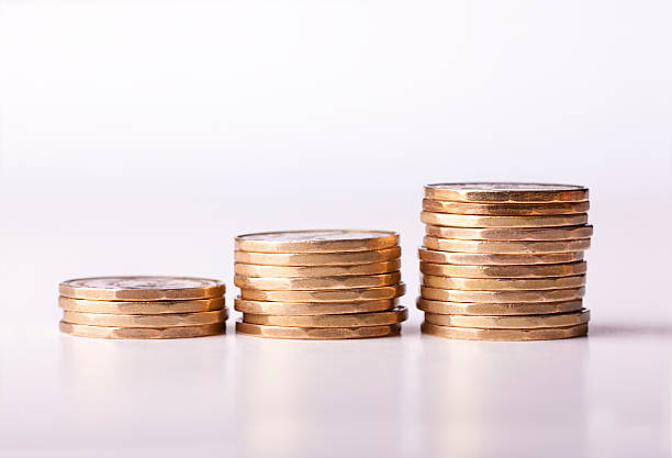 Loonie Inflation with gold coins (Money Series) stock photo