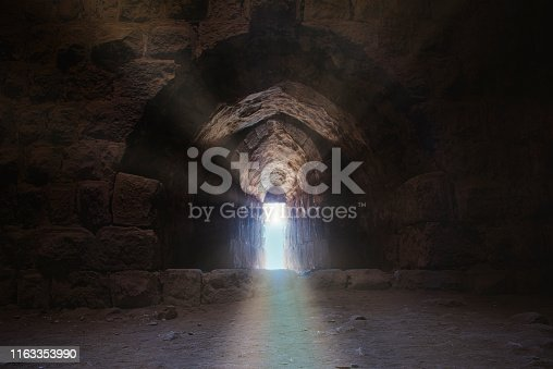 light is pouring in through an arrow slit in the walls of the Karak castle