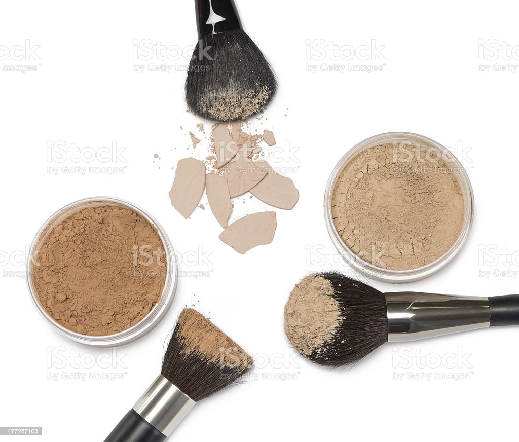 Loose and compact powder with makeup brushes stock photo